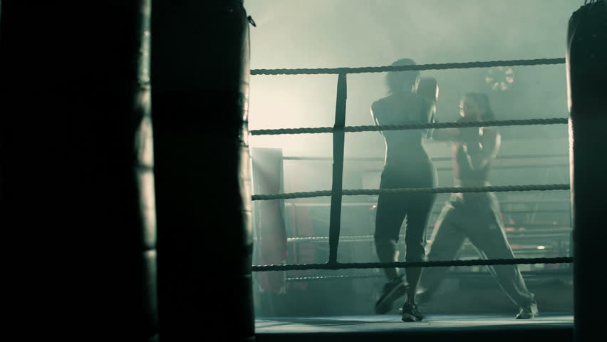 Female Boxers traing together in the Boxing Ring building up to a fight