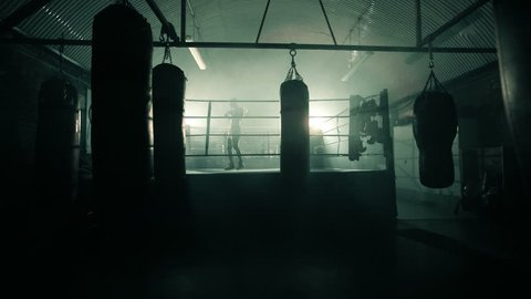 Male Boxer enters the ring and prepares for the fight