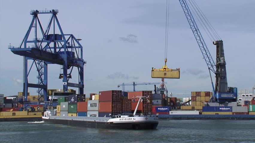 PORT OF ROTTERDAM-WAALHAVEN - 9 april 2014: Activity in Waalhaven Container Terminal for deepsea and barge containers.
