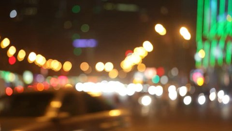Night city lights and traffic background. Out of focus background with blurry unfocused city lights and driving cars and car light. Moscow, Russia