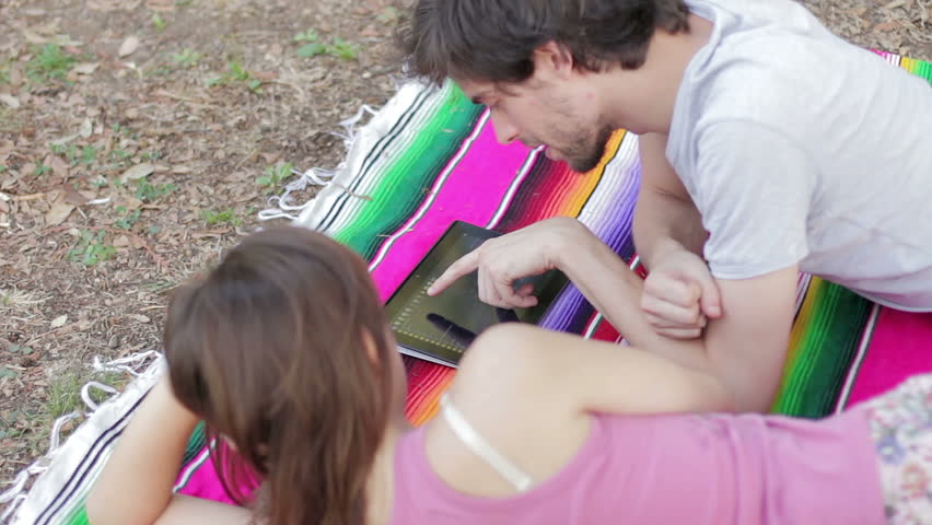 Tablet - Happy young couple using a tablet computer in the park | Shutterstock HD Video #6149507