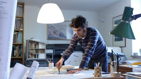 architect working on a drawing
