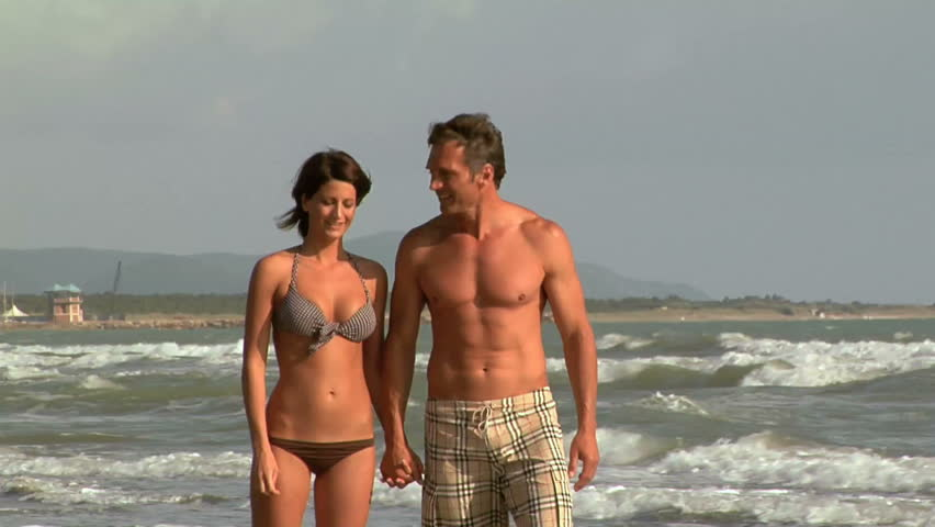 Adult couple walking on the beach