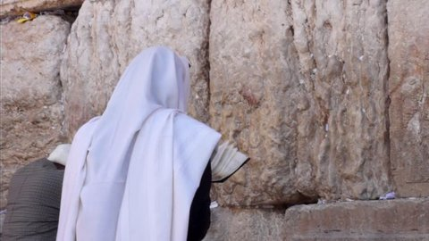 Jewish man prays at the western wall