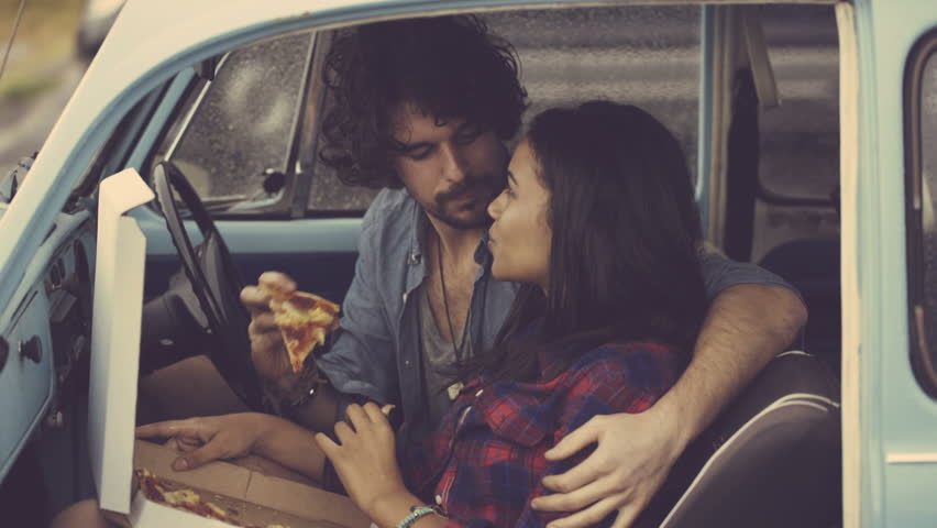 Couple eating pizza in retro car | Shutterstock HD Video #6223247