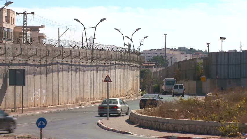 WEST BANK BARRIER, PALESTINIAN TERRITORIES, ISRAEL CIRCA 2013 - Cars drive along the new West Bank Barrier between Israel and the Palestinian territories.