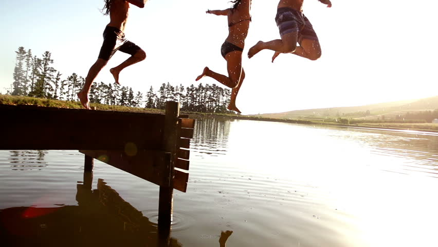 Jumping into the lake from a jetty in slow motion
