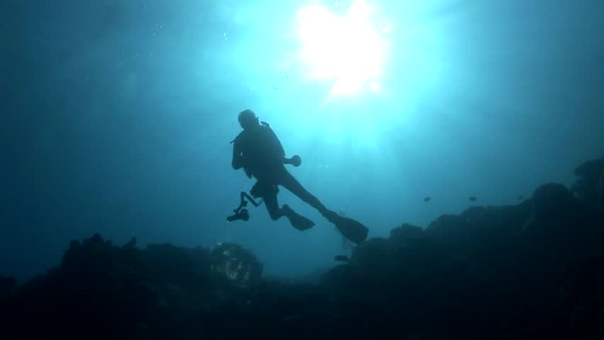 Divers in backlight in crystal clear water | Shutterstock HD Video #6271691