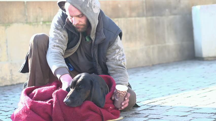 PRAGUE, CZECH REPUBLIC - FEBRUARY 1 : Homeless man and his dog in streets on February 1, 2014 in Prague, Czech Republic.