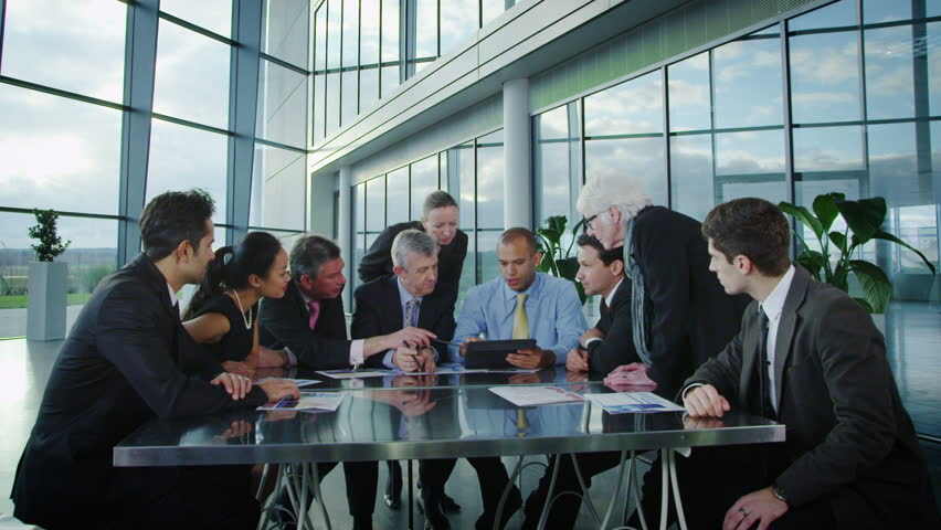 Cheerful diverse business group with a tablet computer in a business meeting | Shutterstock HD Video #6284507