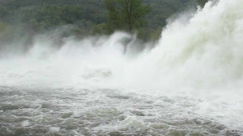 powerful and beautiful cascade created rushes water from open dam and falls in the river