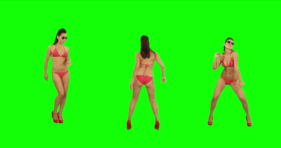 Beautiful young girl in bikini dancing against green screen. Just like beach party!
