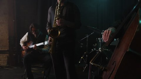 Panning shot of musicians playing instruments