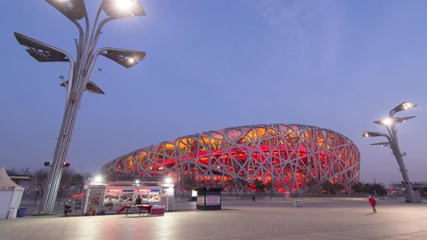 Beijing,China. Jan,2014. Timelapse/Hyperlapse of The Bird's Nest National Stadium in evening. Landmark building of Beijing in Olympic Sports Centre. 4K