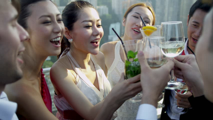 Dinner Party Video Part - 39: Confident Young Male Female Asian Chinese Caucasian Financial Brokers  Toasting Future Outdoors Rooftop Bar City Skyscrapers
