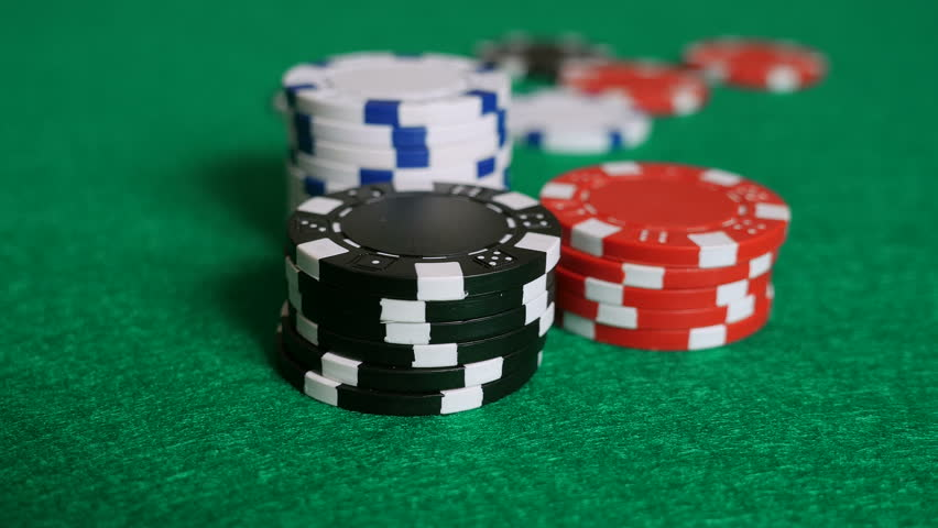 & Stock video of falling poker chips on a game | 6437897 | Shutterstock