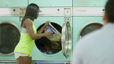A Young Man and a Young Woman meet in a Launderette whilst doing their laundry