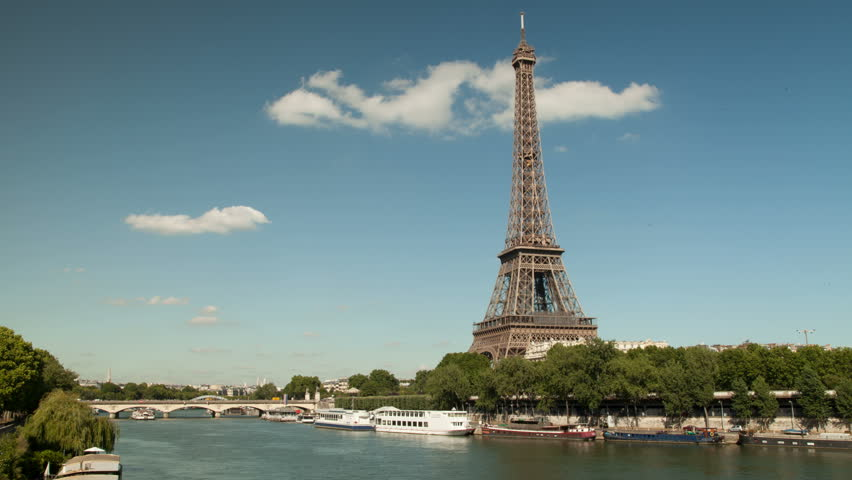 Timelapse of the Eiffel tower and the Seine with boats. . Boats with tourists and goods are passing by. This timelapse is in 4K, Ultra high definition. | Shutterstock HD Video #6448109