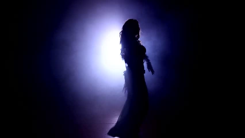 Video footage of a Belly Dance with a Woman in the backlight with smoke #6460487