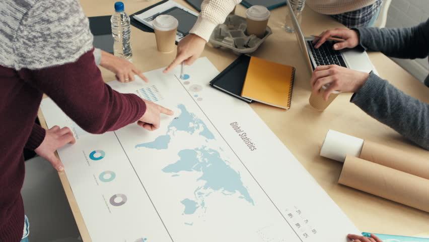 Business team discuss global market trends | Shutterstock HD Video #6483584