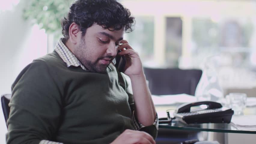 Man on phone in office | Shutterstock HD Video #6495647