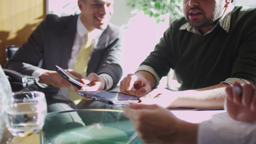 Office workers discuss plans | Shutterstock HD Video #6496718