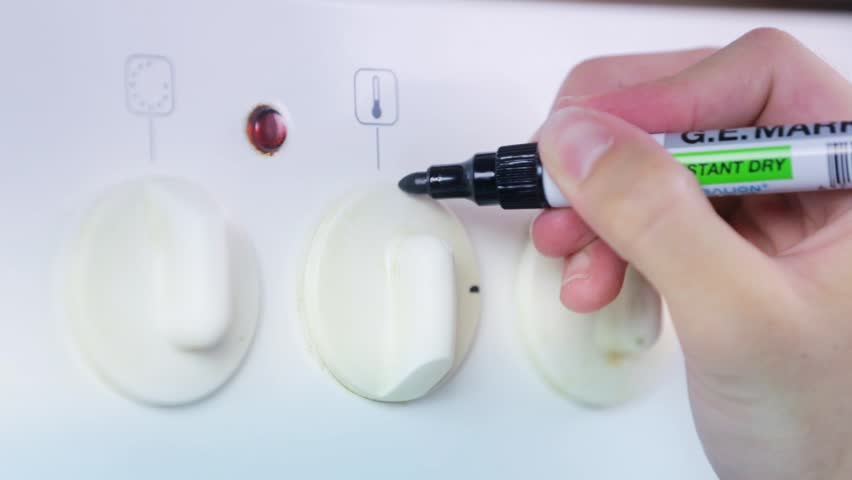 Making Black Marks on Oven Button | Shutterstock HD Video #6503117