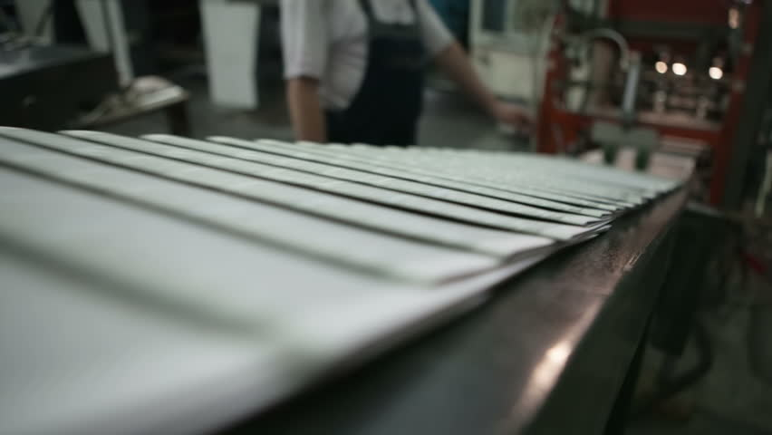 Ready newspaper on production line. RAW video.