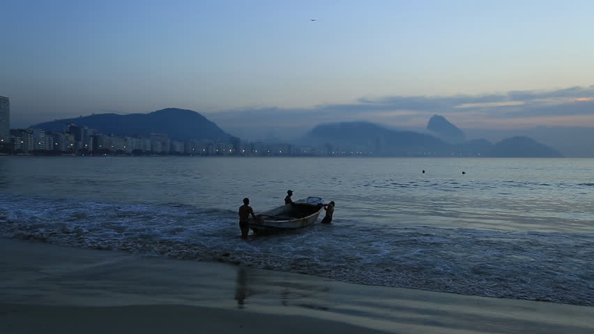 Fishermen push their boat out to sea in Brazil at sunset | Shutterstock HD Video #6514307