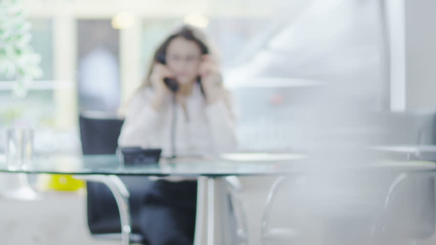 Office woman on the phone | Shutterstock HD Video #6532367