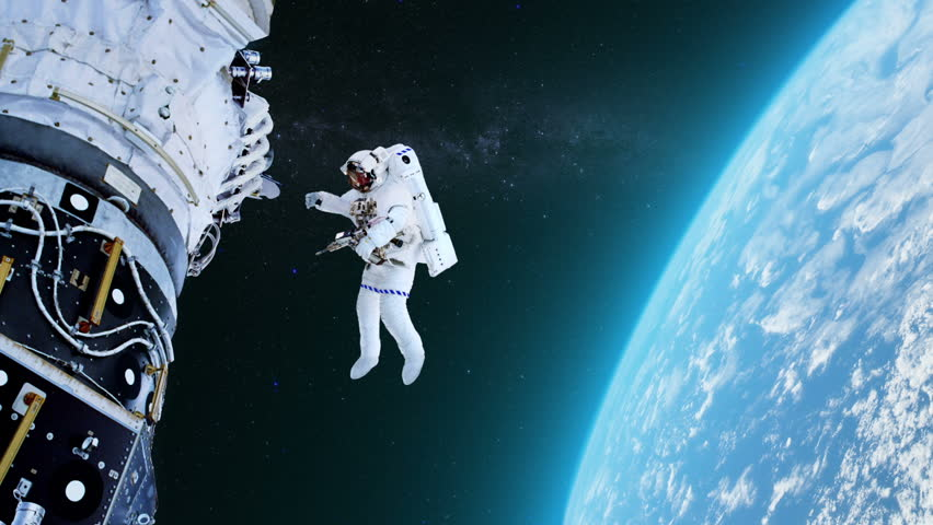 Astronaut Working On International Space Station. Elements ...