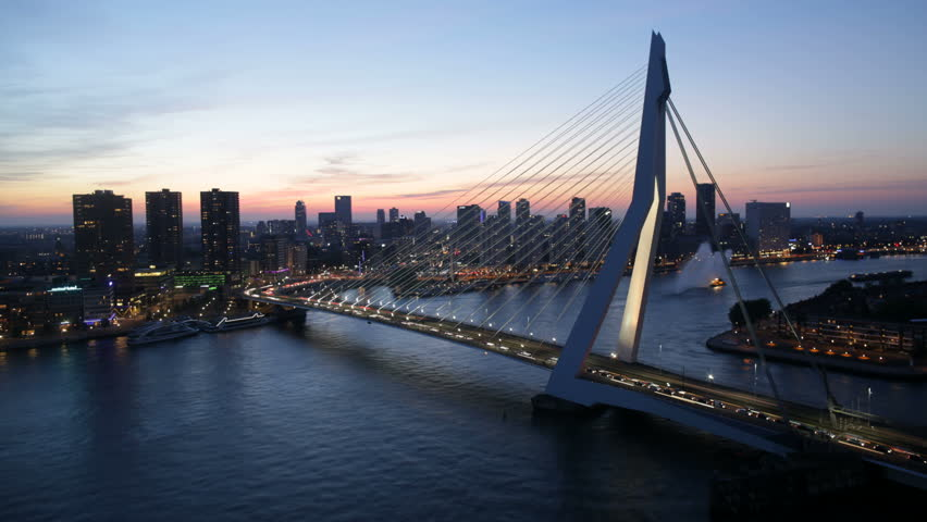 Timelapse of the skyline of Rotterdam, the Netherlands, with the Erasmus bridge. Also available in 4K.    Shutterstock HD Video #6541307