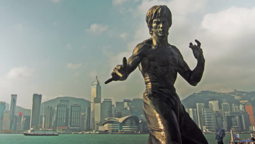 HONG KONG - SEPTEMBER 12, 2013: Statue of Bruce Lee, a Kung Fu Hero icon. Shot in Avenue of the Stars, Tsim Sha Tsui, Kowloon, Hong Kong.