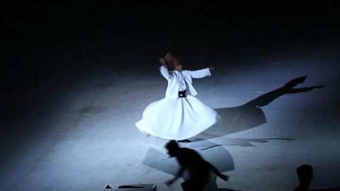 MERSIN, TURKEY - JUNE 20, 2013:  Whirling Dervish sufi religious dance (Semazen)  - 17. Mediterranean Games, Opening ceremony of Mersin stadium