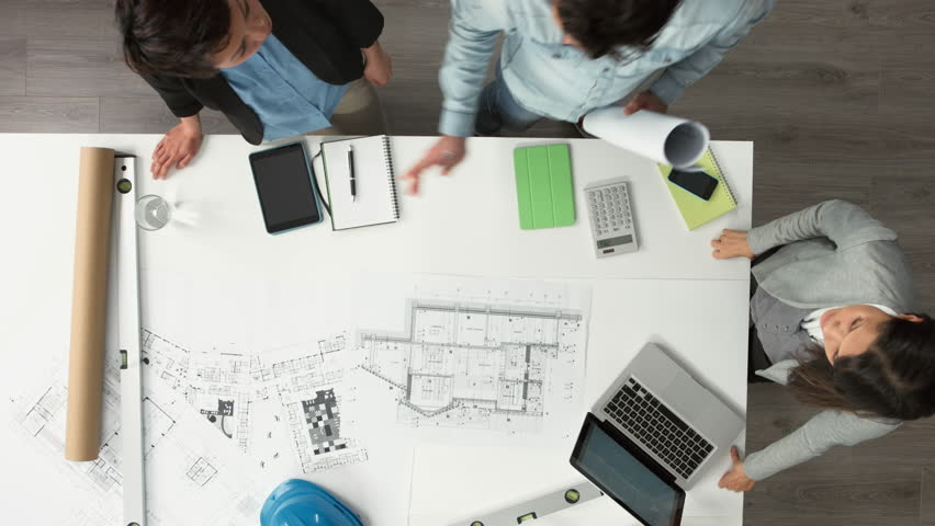 Architect plans arial view business meeting showing teamwork young diverse startup | Shutterstock HD Video #6554477