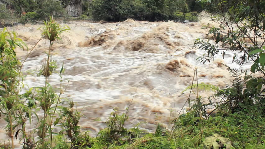 Rio Quijos in flood after a tropical storm. A tributary of the Amazon on the eastern slope of the Andes in Ecuador.
