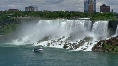 NIAGARA FALLS, CANADA - Circa, June, 2014 - Tourists aboard The Maid of the Mist Tour boat sail past the American Falls.