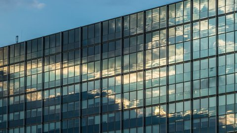 clouds reflection on a glass facade - modern office Building - Hamburg - DSLR time lapse