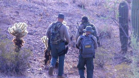 Three Border Patrol Agents on Patrol in Desert Near Mexico Border