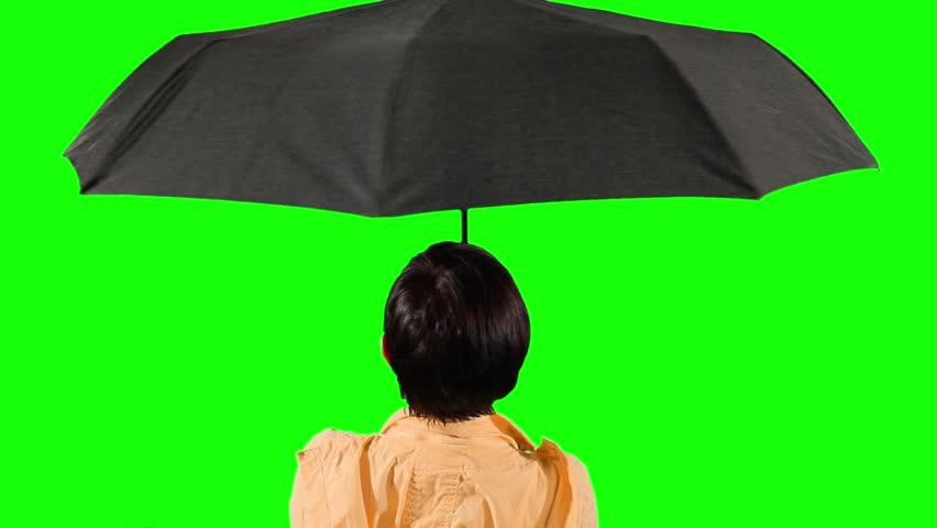 Close-up of a woman opens an umbrella. Green screen.