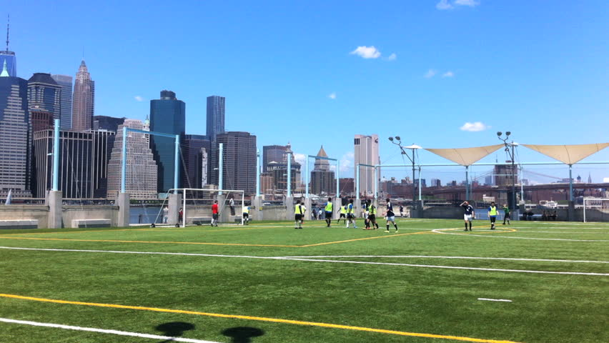 A Soccer Football Game Takes Place Amongst Intramural Players In Front Of The New York