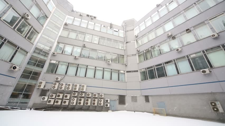 Vertical review commercial office building in snowy winter day | Shutterstock HD Video #6612137