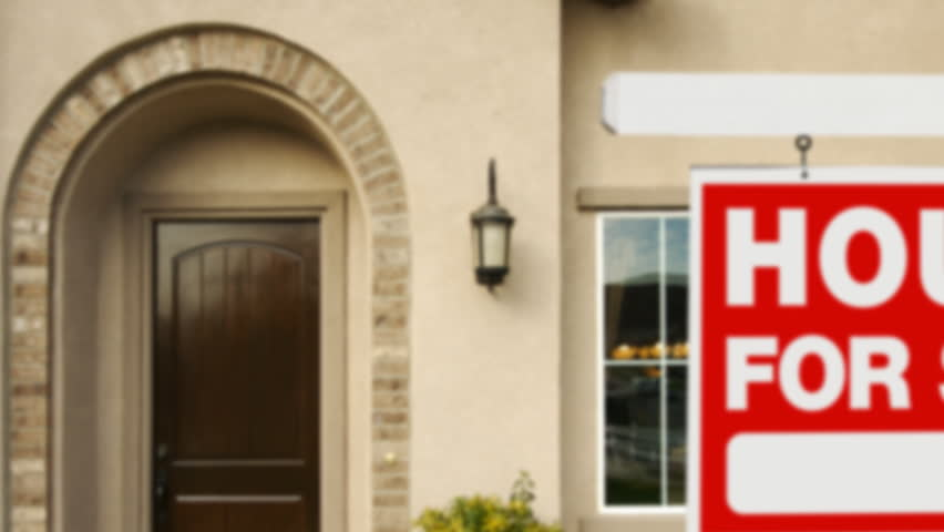 Panning Home For Sale Sign and House.