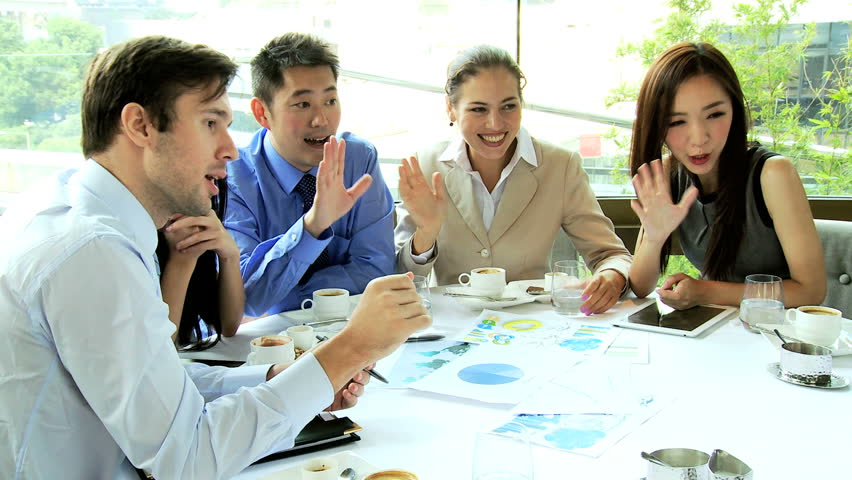 Male female Asian Chinese Caucasian business partners concluding online video uplink lunch meeting downtown restaurant | Shutterstock HD Video #6646241