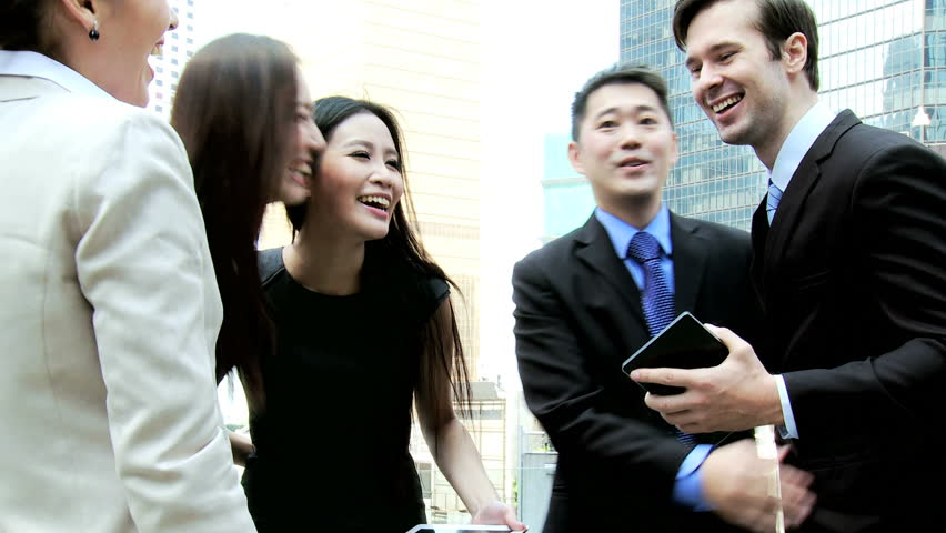 Male female multi ethnic financial team smart business clothes city downtown hot spot outdoors wireless tablets congratulating each other | Shutterstock HD Video #6646703