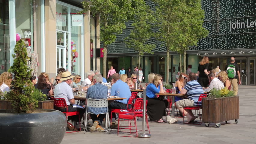 CARDIFF, SOUTH GLAMORGAN/WALES - MAY 18, 2014: Unidentified people enjoy the hot weather at restaurants and cafes in Cardiff City centre on a Summer's day.