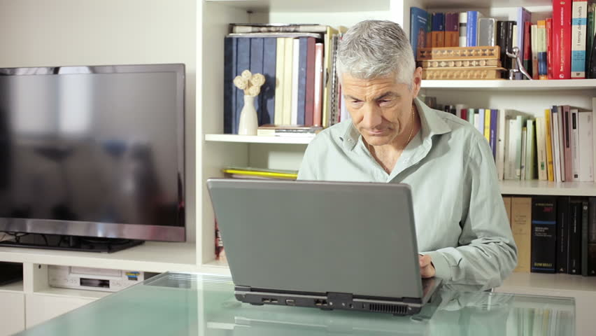 Man using computer on glass table at home in living room: web, technology   Shutterstock HD Video #6706510