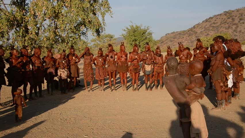 NAMIBIA, AFRICA - JUNE 24: Himba tribe, June 24, 2013. The Himba are indigenous ancient tribe living in Namibia, in one of the most extreme environments on earth. Dancing Himba women,  with sound