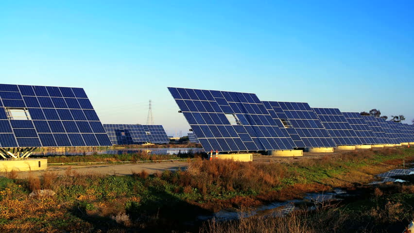 Farms of photovoltaic solar panels producing clean sustainable energy