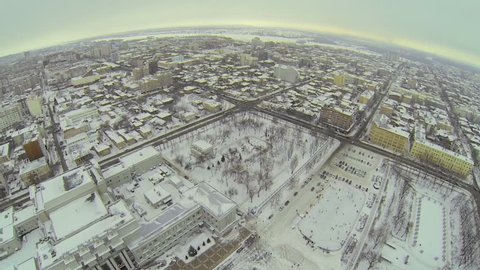 RUSSIA, SAMARA - JAN 6, 2014: Cityscape with skating rinks near edifice of theater on Kuibyshev Square at winter day. Aerial view